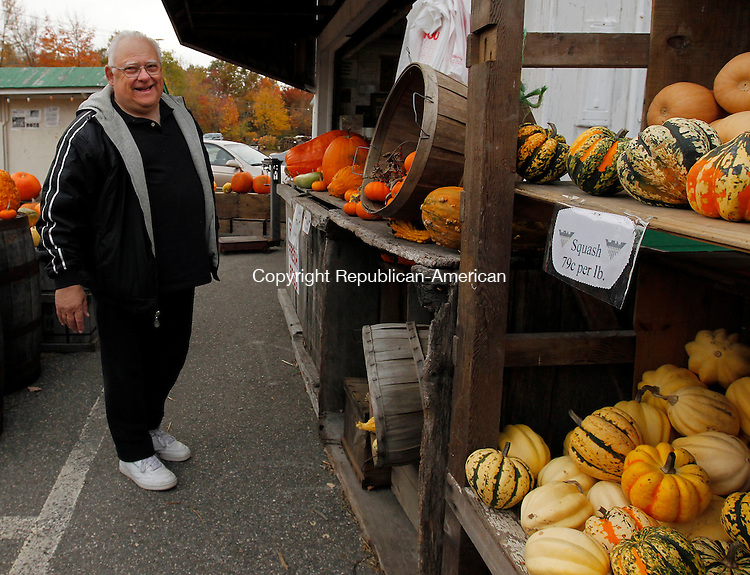 Burlington, CT- 18, October 2010-101810CM08 Joseph Coe, of West Haven, enjoys Hogan's Cider Mill in Burlington Monday afternoon.  Coe stopped by Mill with his wife, both whom have been visiting the market for 15 years.  It's a nice day for leaf peeping, said Coe.  The Coe's were enjoying the fall day by driving through Litchfield County and enjoying the sites.  Christopher Massa Republican-American