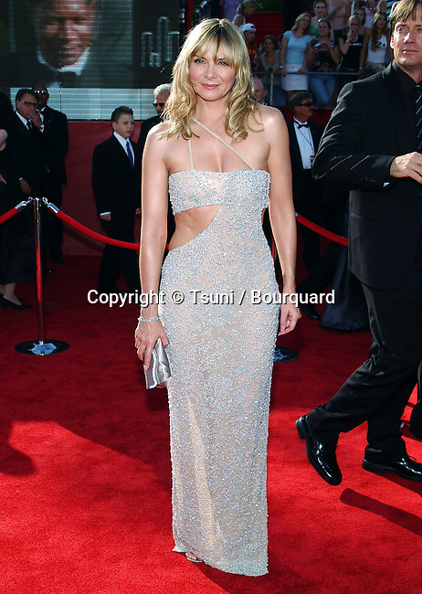 Kim Cattrall arriving at the 55th Annual Emmy Awards at the Shrine Auditorium in Los Angeles. September 21, 2003.
