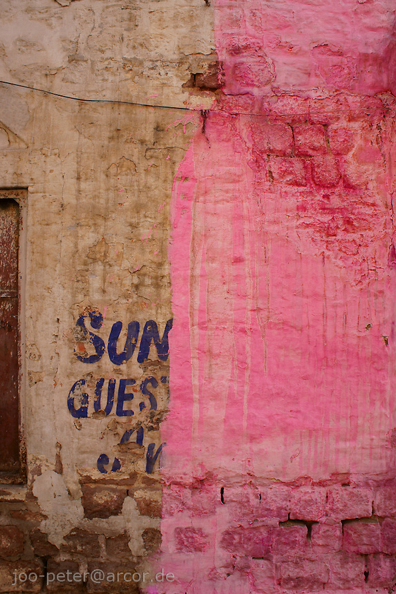 pink wall painting in the streets of Jodhpur,  Rajastan, India