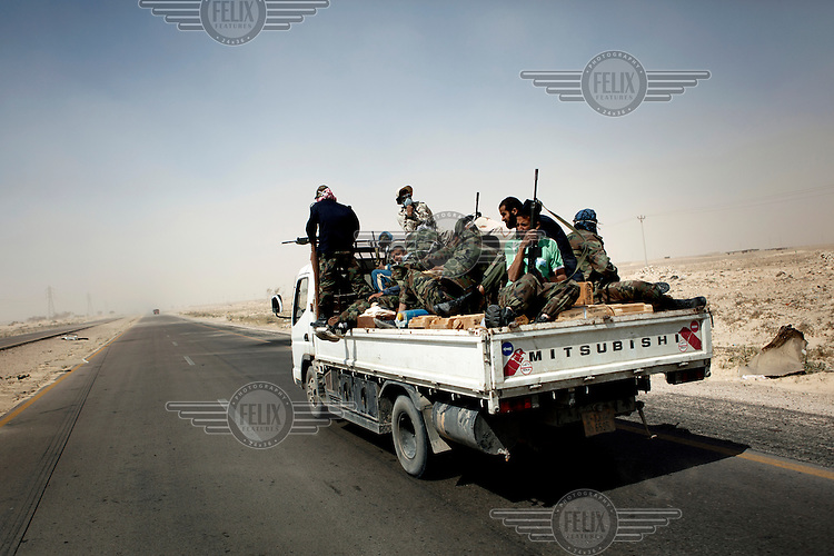 A truck full of ammunition and rebel fighters heads to battle just out of Ajdabiya, 40 kilometers from the frontline. On 17 February 2011 Libya saw the beginnings of a revolution against the 41 year regime of Col Muammar Gaddafi..