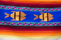 Santa Ana del Valle, Oaxaca; Mexico.  Fish design on carpet by Ernesto Martinez Cruz.