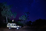 African Lion (Panthera leo) biologist, Xia Stevens, tracking female lion at night, Kafue National Park, Zambia
