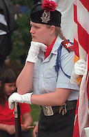 Thoughtful color guard age 17 at the Vietnam Wall on Memorial Day. St Paul Minnesota USA