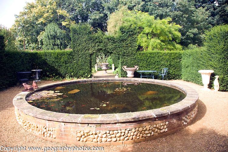 Victorian raised garden ornamental fish-pond in courtyard, the Walled Garden, Benhall, Suffolk, England