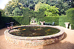 Victorian raised garden ornamental fish-pond in courtyard, the Walled Garden, Benhall, Suffolk, England