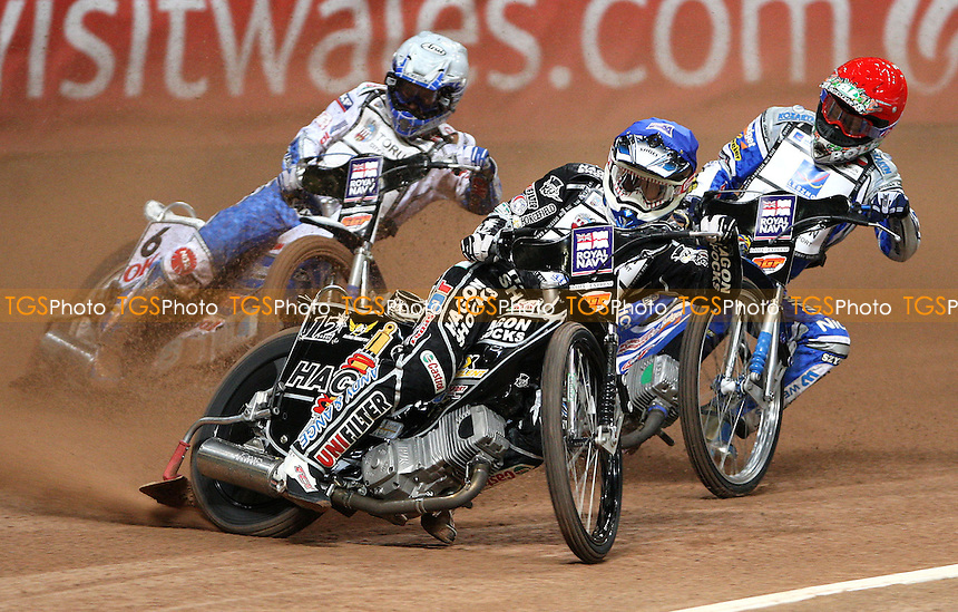 Heat 1: Chris Holder (blue), Rune Holta (red) and Nicki Pedersen (white) - British Speedway Grand Prix at the Millennium Stadium, Cardiff - 10/07/10 - MANDATORY CREDIT: Rob Newell/TGSPHOTO - Self billing applies where appropriate - 0845 094 6026 - contact@tgsphoto.co.uk - NO UNPAID USE.