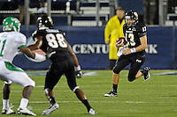 1 September 2011:  FIU quarterback Wesley Carroll (13) scrambles with the ball in the first quarter as the FIU Golden Panthers defeated the University of North Texas, 41-16, at FIU Stadium in Miami, Florida.
