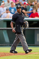 Home plate umpire Ramon DeJesus during a South Atlantic League game between the Greensboro Grasshoppers and the Kannapolis Intimidators at Fieldcrest Cannon Stadium August 2, 2010, in Kannapolis, North Carolina.  Photo by Brian Westerholt / Four Seam Images