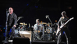 PASADENA, CA. - October 25: Bono, Larry Mullen, Jr., and Adam Clayton perform in concert during their 360º Tour at the Rose Bowl on October 25, 2009 in Pasadena, California.