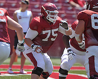 NWA Democrat-Gazette/MICHAEL WOODS &bull; @NWAMICHAELW<br /> University of Arkansas lineman Zach Rogers runs drills during practice Saturday, August 15, 2015 at Razorback Stadium in Fayetteville.