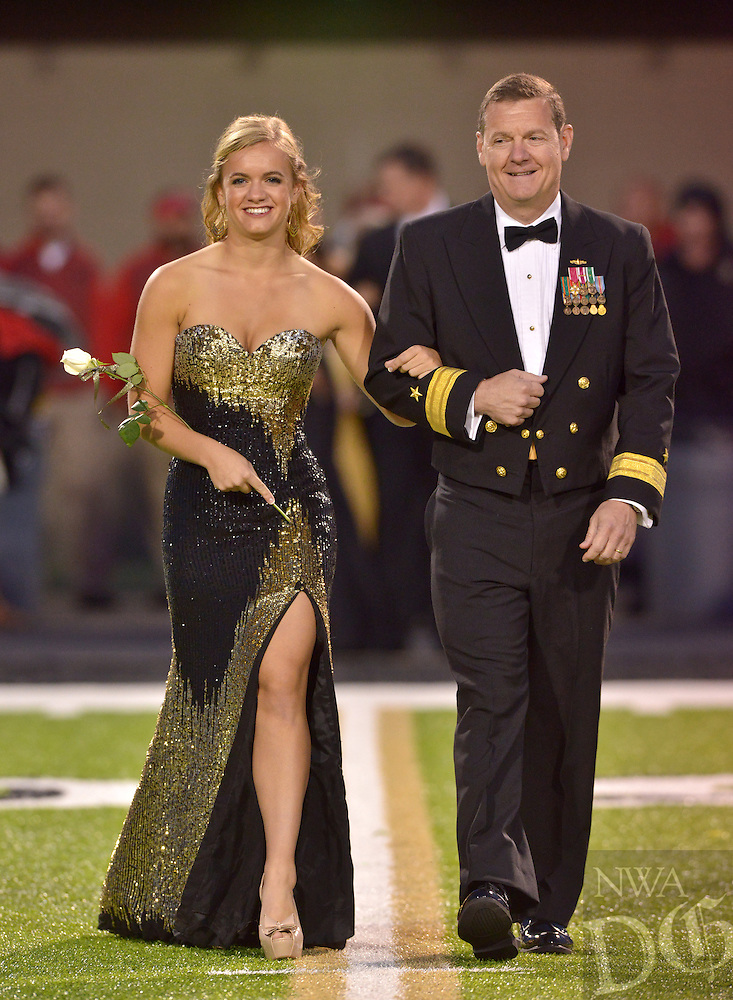 STAFF PHOTO BEN GOFF  @NWABenGoff -- 10/03/14  Jenna McCollum and father Luke McCollum take the field as the 2014 Bentonville High homecoming court is introduced  before the football game against Fort Smith Northside in Bentonville's Tiger Stadium on Friday October 3, 2014.