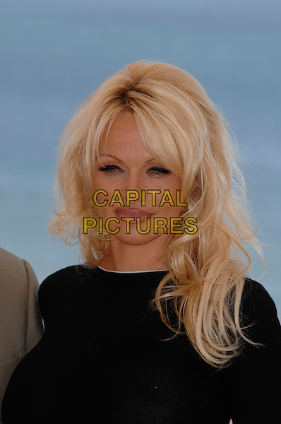 "PAMELA ANDERSON.photocall for ""Blonde and Blonder"" .60th International Cannes Film Festival.Cannes, France 18th May 2007.headshot portrait black top .CAP/PL.©Phil Loftus/Capital Pictures"