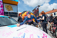 Picture by Allan McKenzie SWpix.com - 03/05/2018 - Cycling - 2018 Tour de Yorkshire - Stage 1: Beverley to Doncaster - JLT Condor, Ian Bibby signs the Global Autocare car.