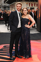 "Elizabeth Olsen and fiance arrives for the ""Godzilla"" premiere at the Odeon Leicester Square, London. 11/05/2014 Picture by: Steve Vas / Featureflash"