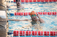 Brandon Kim '18 at the end of the men's 200 yard freestyle. The Occidental College swim team competes against Lewis & Clark College and Westminster College in Taylor Pool on Jan. 6, 2015. (Photo by Marc Campos, Occidental College Photographer)