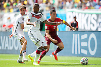 Cristiano Ronaldo of Portugal takes on Jerome Boateng and Thomas Muller of Germany