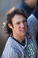 Chase Vogelbach (7) of the Marshall Thundering Herd in the dugout during the game against the Georgetown Hoyas at Wake Forest Baseball Park on February 15, 2014 in Winston-Salem, North Carolina.  The Thundering Herd defeated the Hoyas 5-1.  (Brian Westerholt/Four Seam Images)