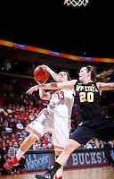 Ohio State Buckeyes guard Cait Craft (13) is fouled by Appalachian State Mountaineers guard Katie Mallow (20) as she shoots a layup during the second half of the NCAA women's basketball game between the Ohio State Buckeyes and the Appalachian State Mountaineers at Value City Arena in Columbus, Ohio, on Friday, Dec. 20, 2013. The Buckeyes overcame a 21-18 deficit at the half to defeat the Mountaineers 52-38.  (Columbus Dispatch/Sam Greene)