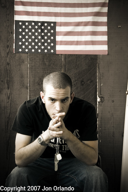 Jared Hood, an Iraq War Veteran and Denver chapter president of the Iraq Veterans Against the War, photographed at his home in Denver, CO.