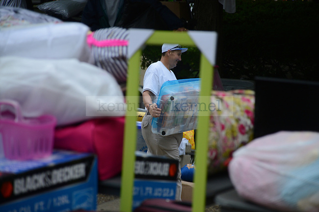 A volunteer helps during freshman move in day on South Campus on August 17th, 2012. Photo by Mike Weaver