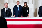 US President Donald J. Trump and First Lady Melania Trump pay their respects in front of the flag-draped casket of late US Supreme Court Justice John Paul Stevens as he lies in repose in the Great Hall of the Supreme Court, in Washington, DC, USA, 22 July 2019. Stevens, who served on the Supreme Court for nearly thirty-five years, died at age ninety-nine, 16 July.<br /> Credit: Michael Reynolds / Pool via CNP