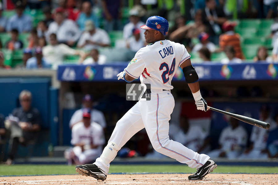 7 March 2009:  #24 Robinson Cano of the Dominican Republic hits the ball during the 2009 World Baseball Classic Pool D match at Hiram Bithorn Stadium in San Juan, Puerto Rico. Netherlands pulled off a huge upset in their World Baseball Classic opener with a 3-2 victory over Dominican Republic.