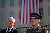 General Joseph Dunford, Chairman of the Joint Chiefs of Staff, right, and Jim Mattis, United States Secretary of Defense, listen during a ceremony to commemorate the September 11, 2001 terrorist attacks with U.S. President Donald Trump, not pictured, at the Pentagon in Washington, D.C., U.S., on Monday, Sept. 11, 2017. Trump is presiding over his first 9/11 commemoration on the 16th anniversary of the terrorist attacks that killed nearly 3,000 people when hijackers flew commercial airplanes into New York's World Trade Center, the Pentagon and a field near Shanksville, Pennsylvania. <br /> Credit: Andrew Harrer / Pool via CNP