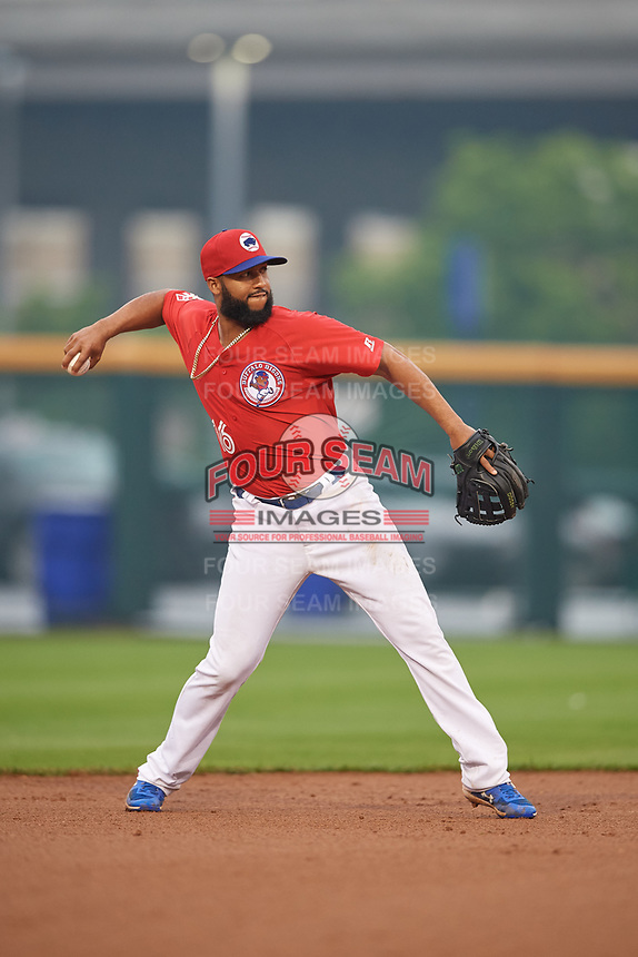 Buffalo Bisons shortstop Richard Urena (16) warmup throw to first base during an International League game against the Scranton/Wilkes-Barre RailRiders on June 5, 2019 at Sahlen Field in Buffalo, New York.  Scranton defeated Buffalo 4-0, the second game of a doubleheader. (Mike Janes/Four Seam Images)
