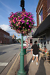 Life in small town America: flowers on a lamp post to beautify the town, Noblesville, Indiana, IN, USA