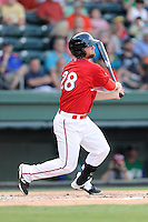 First baseman Sam Travis (28) of the Greenville Drive bats in a game against the Lexington Legends on Friday, August 29, 2014, at Fluor Field at the West End in Greenville, South Carolina. Travis is a second-round pick of the Boston Red Sox in the 2014 First-Year Player Draft out of the Indiana University. Greenville won, 6-1. (Tom Priddy/Four Seam Images)