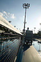 Flushing, NY - 17 August 2005 - A staff member riding his machine practices  his court drying techniques at the National Tennis Center - home of the US Open - in Flushing, Queens, NY, USA, 17 August 2005.