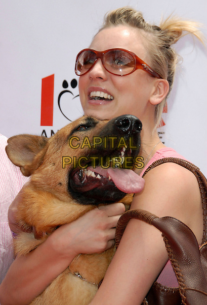 KALEY CUOCO.attends The Kick off of The Old Navy Nationwide Canine Mascot Search held at Franklin Canyon Park in Beverly Hills, Los Angeles, California, USA,.April 29 2006..half length dog pet animal hugging funny.Ref: DVS.www.capitalpictures.com.sales@capitalpictures.com.©Debbie VanStory/Capital Pictures