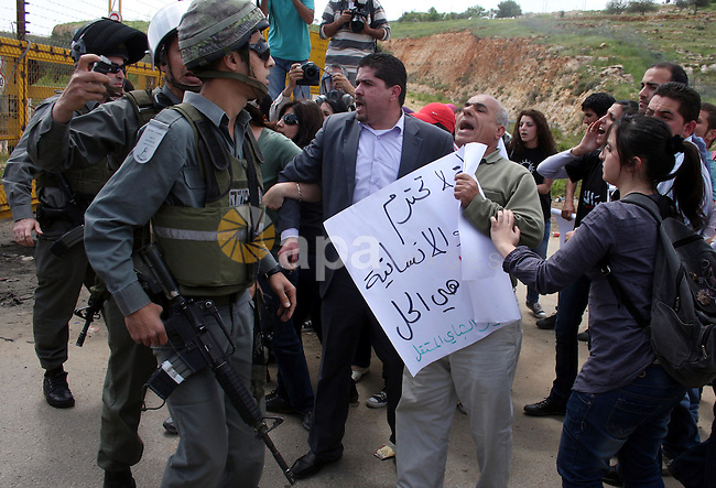 Palestinians and foreigners argue with Israeli soldiers during a protest outside Ofer prison, near the West Bank city of Ramallah, April 17, 2011, calling for the release of Palestinian prisoners from Israeli jails. April 17 marks Palestinian Prisoners Day. Photo by Issam Rimawi