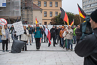 """Rechte demonstrieren in Bautzen gegen Fluechtlinge.<br /> Am Sonntag den 18. September 2016 versammelten sich im saechsischen Bautzen ca. 120 Rechte zu einem Kundgebung mit anschliessender Demonstration um gegen Fluechtlinge zu demonstrieren. Sie riefen Parolen gegen Fluechtlinge und gegen Angela Merkel und beschimpften Medienvertreter als """"Volksverraeter"""".<br /> Nach Aussagen von Anwohnern waren nur etwa 15 Teilnehmer aus Bautzen. Bautzener Rechtsextreme hatten zuvor aufgerufen, sich vorerst nicht an Demonstrationen zu beteiligen, bis ein von ihnen an die Stadtverwaltung gestelltes Ultimatum, zu Loesung der Fluechtlingsfrage verstrichen ist.<br /> Links im Bild: Eine Handvoll Mitglieder der Kleinstpartei PRO-NRW ist eigens fuer diesen Tag nach Bautzen gereist.<br /> 18.9.2016, Bautzen/Sachsen<br /> Copyright: Christian-Ditsch.de<br /> [Inhaltsveraendernde Manipulation des Fotos nur nach ausdruecklicher Genehmigung des Fotografen. Vereinbarungen ueber Abtretung von Persoenlichkeitsrechten/Model Release der abgebildeten Person/Personen liegen nicht vor. NO MODEL RELEASE! Nur fuer Redaktionelle Zwecke. Don't publish without copyright Christian-Ditsch.de, Veroeffentlichung nur mit Fotografennennung, sowie gegen Honorar, MwSt. und Beleg. Konto: I N G - D i B a, IBAN DE58500105175400192269, BIC INGDDEFFXXX, Kontakt: post@christian-ditsch.de<br /> Bei der Bearbeitung der Dateiinformationen darf die Urheberkennzeichnung in den EXIF- und  IPTC-Daten nicht entfernt werden, diese sind in digitalen Medien nach §95c UrhG rechtlich geschuetzt. Der Urhebervermerk wird gemaess §13 UrhG verlangt.]"""