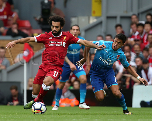 27th August 2017, Anfield, Liverpool, England; EPL Premier League football, Liverpool versus Arsenal; Mohammed Salah of Liverpool is challenged by Alexis Sanchez of Arsenal