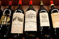 Fine wines Chateau Canon, Chateau Fonplegade, Clos des Jacobins Chateau Palmer Medoc in wine merchants shop in St Emilion, Bordeaux, France
