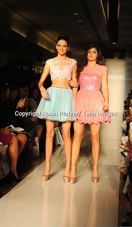 Kendall Jenner and sister Kylie Jenner model in  the Sherri Hill Spring 2012 Fashion Show on September 7, 2012 at Trump Tower in New York City.