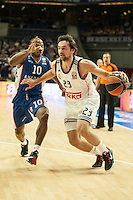 Real Madrid´s Sergio Llull and Anadolu Efes´s Donate Draper during 2014-15 Euroleague Basketball match between Real Madrid and Anadolu Efes at Palacio de los Deportes stadium in Madrid, Spain. December 18, 2014. (ALTERPHOTOS/Luis Fernandez) /NortePhoto /NortePhoto.com