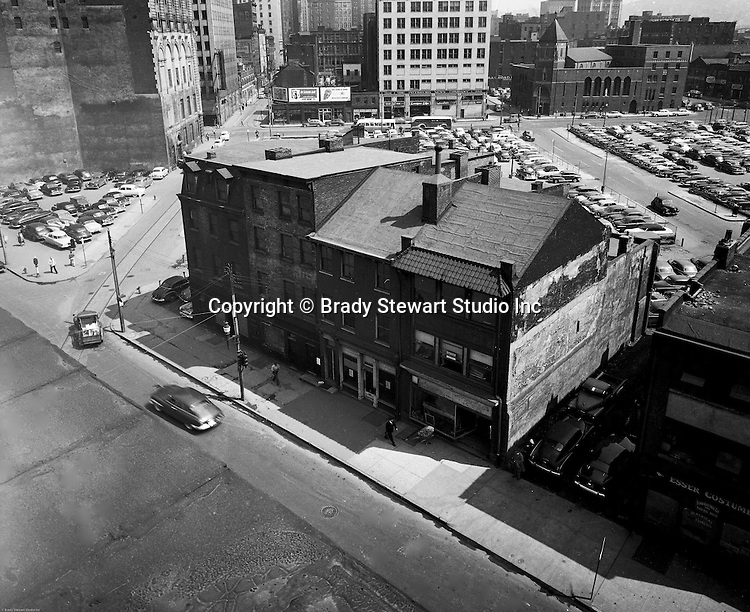Pittsburgh PA:  View of the city of Pittsburgh before Gateway Center - 1949.  The corner of Liberty Avenue and 4th Avenue.  Company signs on the city buildings include: Salvation Army billboard, 1940s Texaco Gas billboard, 1940s billlboards, 1940s parking lots in Pittsburgh, 3rd Avenue, 3rd Avenue in Pittsburgh, Esser Costume, Fourth Avenue in Pittsburgh, G&W Leach Company, Kelly Tires on Boulevard of the Allies, Knapp Brothers Company on Boulevard of the Allies, Lord Electric Company, Minsky Brothers & Company on Stanwix Street, St Mary of Mercy Church, The Pittsburg News Company on Stanwix Street