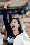 Actress Mimi Rogers waves to fellow actress, Victoria Pratt, to acknowledge that they both made the money.