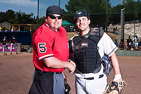 24 May 2009: Home plate umpire Gerald Lacoste poses with Vincent Ferreira of Savigny during the 2009 challenge de France, a tournament with the best French baseball teams - all eight elite league clubs - to determine a spot in the European Cup next year, at Montpellier, France. Rouen wins 7-5 over Savigny.