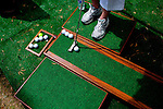 Cindy Sanders putts on a ten foot indoor wooden putting green by ProZoco outside of The Masters golf tournament on in Augusta, Georgia April 7, 2010. The green, which is offered in three sizes is offered at a discounted price for the tournament.