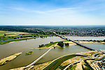 Nederland, Gelderland, Nijmegen, 09-06-2016; de nieuw aangelegde nevengeul van de rivier de Waal, ontstaan door de dijkverlegging bij Lent, gezien naar de binnenstad van Nijmegen. Onderdeel van het project Ruimte voor de River (Ruimte voor de Waal). Links van het midden de ingang van de nevengeul met drempel.<br /> The finished dike relocation of Lent (project Ruimte voor de Rivier: Room for the River) with the resulting flood trench. Left of the center the entrance to the secondary channel with the threshold. In the background the city of Nijmegen.<br /> luchtfoto (toeslag op standard tarieven);<br /> aerial photo (additional fee required);<br /> copyright foto/photo Siebe Swart