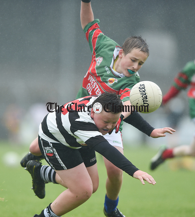 Ben Mc Namara of Clarecastle is tackled by Clooney-Quin's Calum Byrne during the U-12 football final in Cusack park. Photograph by John Kelly.