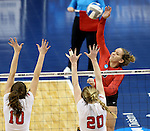 SIOUX FALLS, SD - DECEMBER 8:  Kayce Krucki #5 from Wheeling Jesuit looks to get the ball past Caroline Stefanon #10 and Maddie Seliga #20 from Lewis during their quarterfinal match at the 2016 Women's Division II Volleyball Championship at the Sanford Pentagon in Sioux Falls, SD. (Photo by Dave Eggen/Inertia)