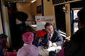Columbia, South Carolina.USA.February 3, 2004..Senator Johon Edwards makes a stop at a polling station on election day in South Carolina and speaks breifly with the press. A group of kindergarden childern from North Minster school greet the Senator aboard his bus just by chance.