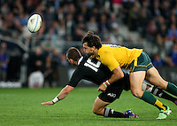 New Zealand's Aaron Cruden, left, in the tackle of Australia's Adam Ashley-Cooper in the Bledisloe Cup rugby match, Forsyth Barr Stadium, Dunedin, New Zealand, Saturday, October 19, 2013. Credit:SNPA / Dianne Manson.