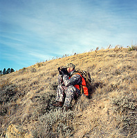 John Taranto, a writer with Outdoor Life Magazine hunts at Trope Ranch near Hullett, Wyoming, Wednesday, November 7, 2012.<br /> <br /> <br /> Photo by Matt Nager
