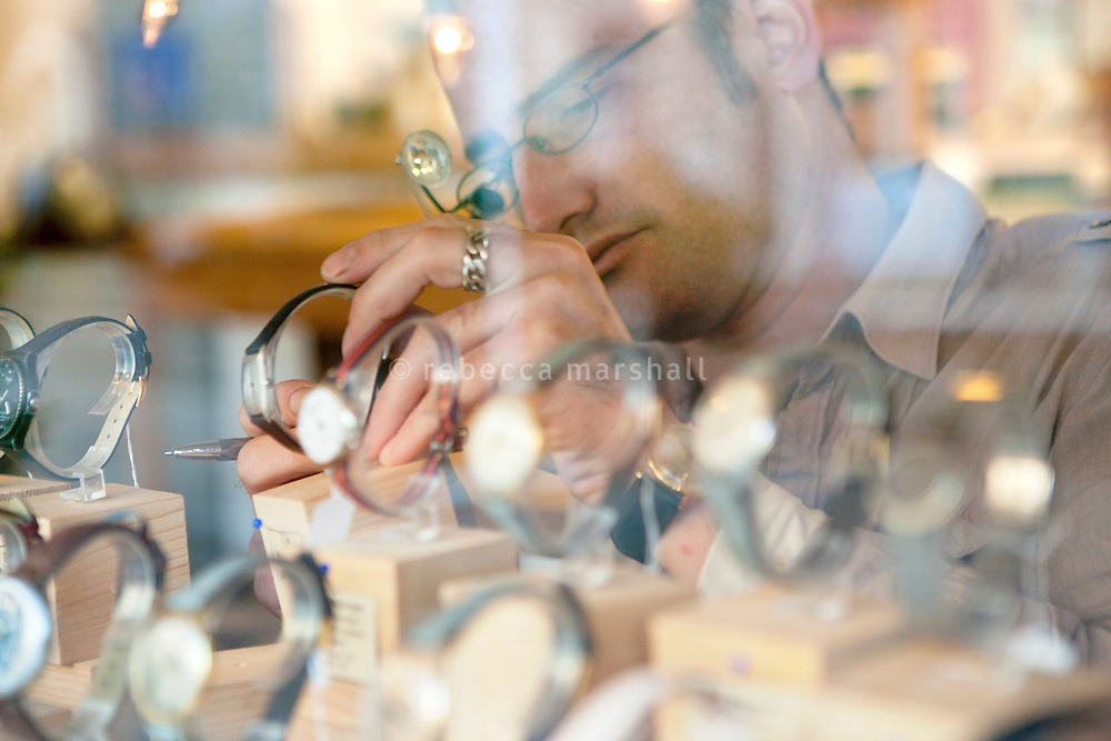 Florian Wulleman puts a watch on display at this shop l'Atelier d'Horlogerie, Place du Frene, Vence, France, 17 November 2010