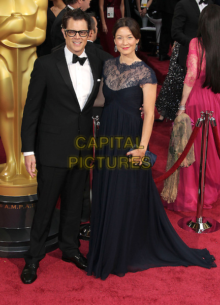 02 March 2014 - Hollywood, California - Johnny Knoxville, wife Naomi Knoxville. 86th Annual Academy Awards held at the Dolby Theatre at Hollywood &amp; Highland Center. <br /> <br /> CAP/ADM/RE<br /> &copy;Russ Elliot/AdMedia/Capital Pictures